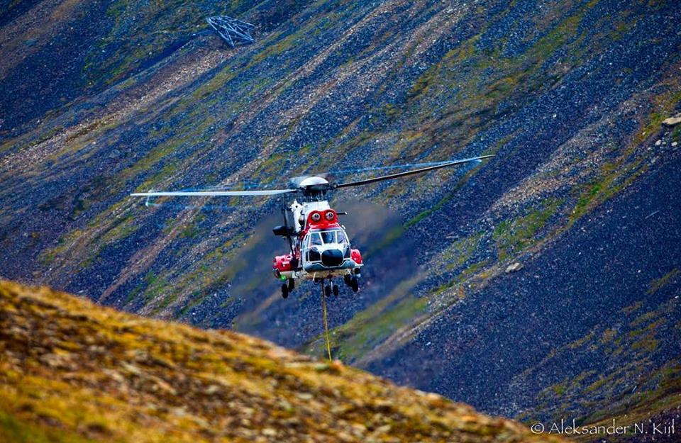 An Airbus AS332 Super Puma performs long line operations in Longyearbyen. Photo submitted by Alexander Kiil (Instagram user @aleksanderkiil) using #verticalmag