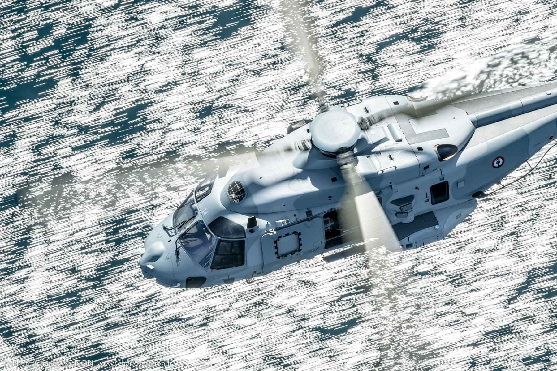 A NHIndustries NH90 flies over the Iroise Sea toward Crozon, France. Photo submitted by Charles Marion
