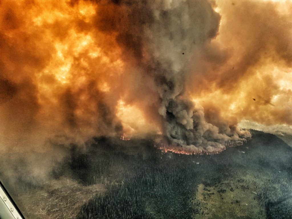 The heavy smoke in B.C. has been hindering flight operations, as in some areas the smoke is too thick to fly. Shown is one of the many fires burning in the B.C. interior, taken from a Yellowhead helicopter. Richard Yuen Photo