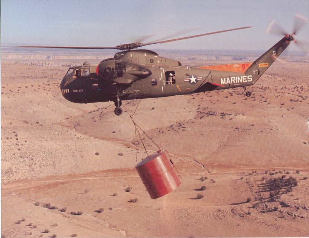 A U.S. Marine HR2S-1 Deuce helicopter slinging a tank over the desert. The helicopter was capable of lifting up to 10,000 pounds. Jeff Evans Collection Photo