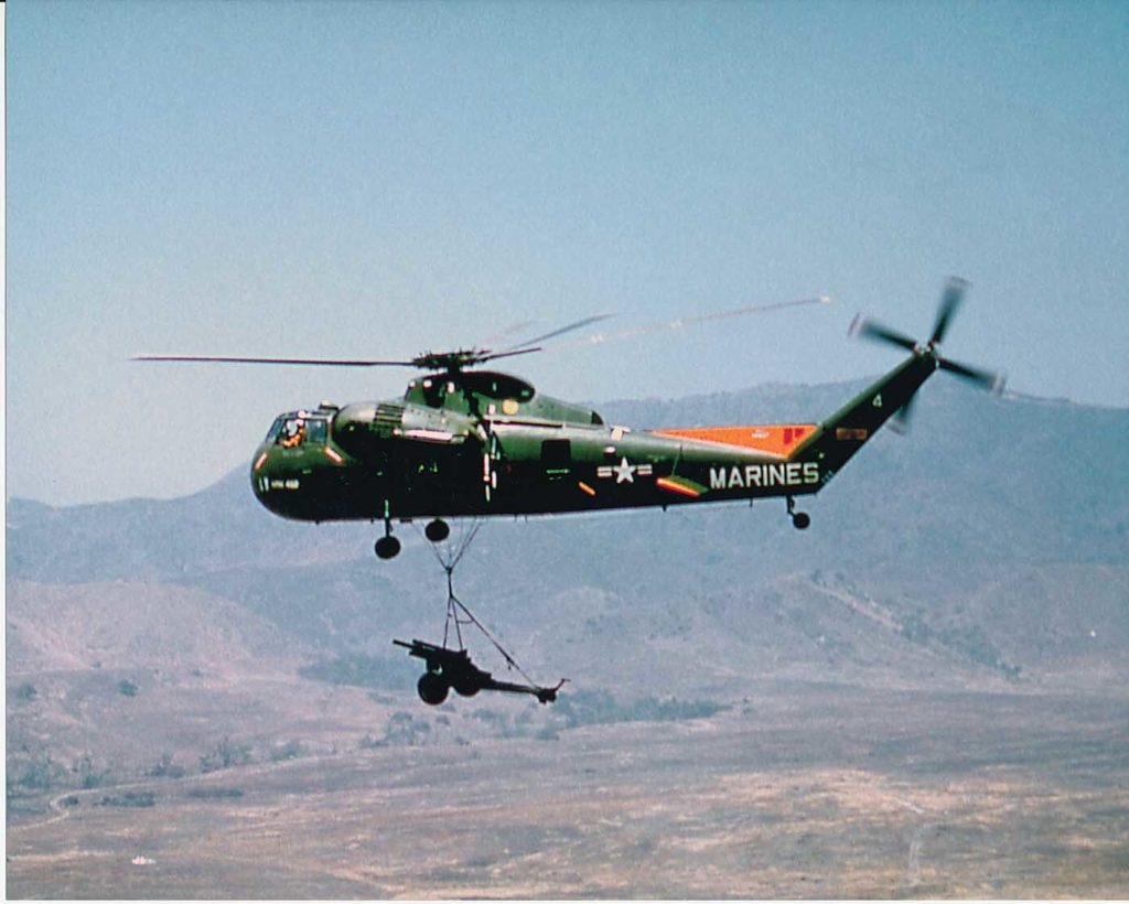 The U.S. Marine Corps HR2S-1 helicopter was one of the first rotary-wing aircraft capable of lifting heavy equipment that supported the Marines. Jeff Evans Collection Photo
