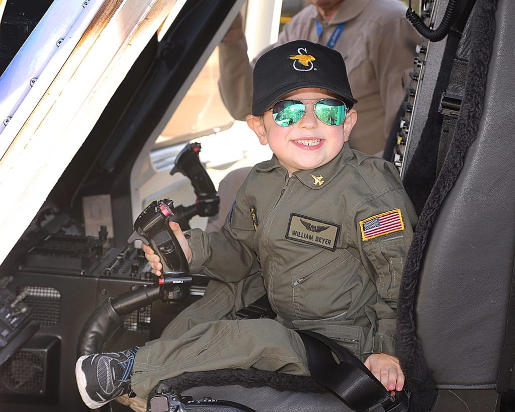 Six-year-old William Beyer sits in the cockpit of a Sikorsky S-76 helicopter.