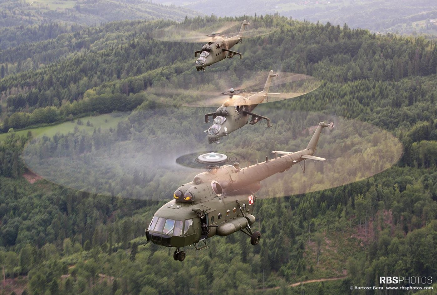 A Polish Mil Mi-8 and two Mi-24 Hinds fly in formation. Photo submitted by Bartek Bera