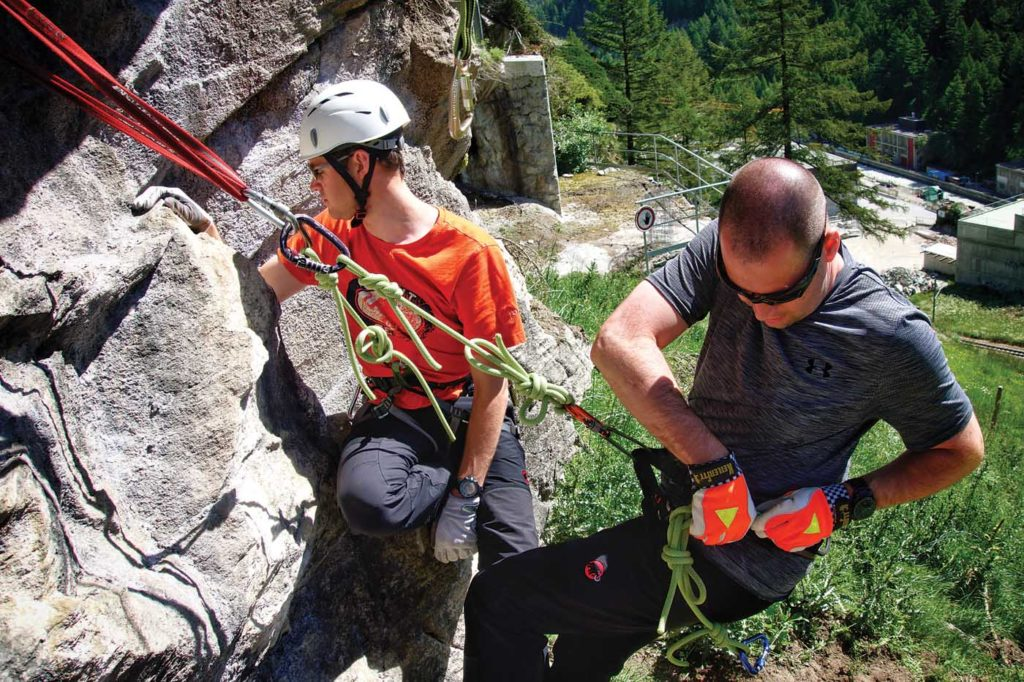 A rock outcrop right above the heliport was the perfect location for vertical wall and rope technique training. Tomas Kika Photo