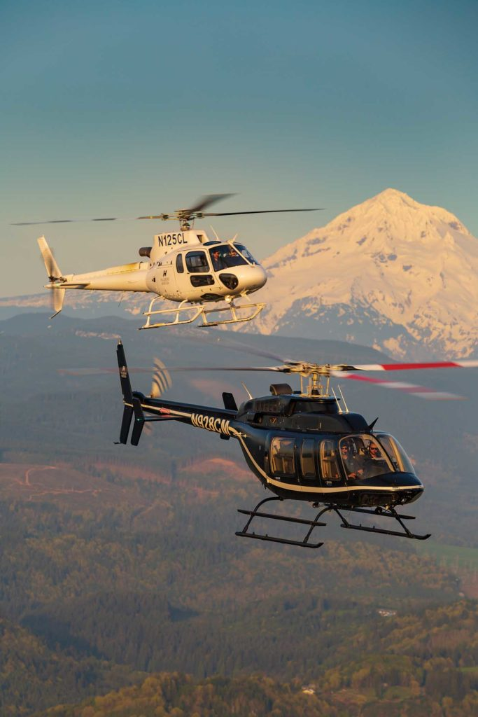An Airbus H125 AStar and a Bell 407 fly together with Mount Hood in the background. The AStars are the latest additions to the Hillsboro fleet, and Lyons said the aircraft have been very well received by customers. Heath Moffatt Photo