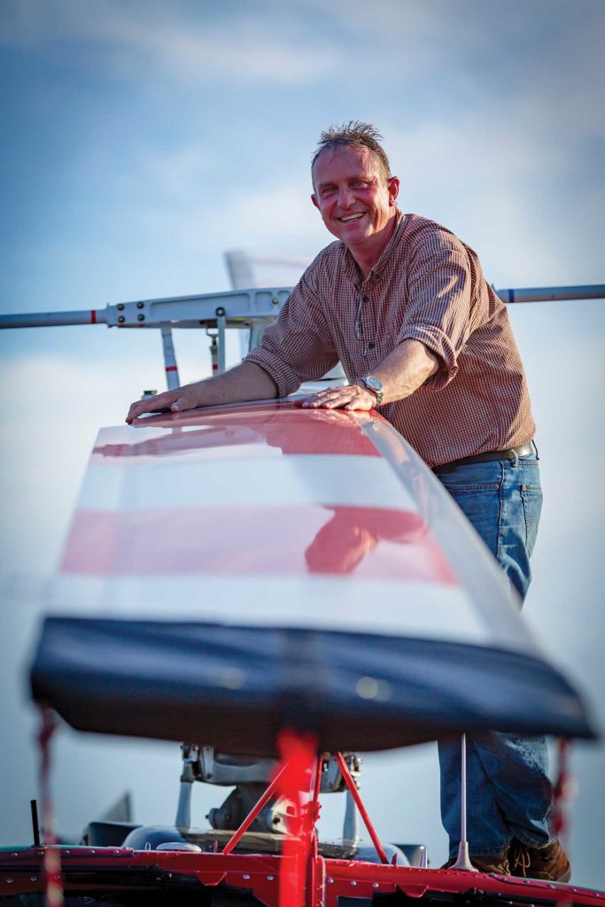 Franz Bergtold, Hillsboro's director of operations, alongside an enormous main rotor blade belonging to a Bell 205. Heath Moffatt Photo