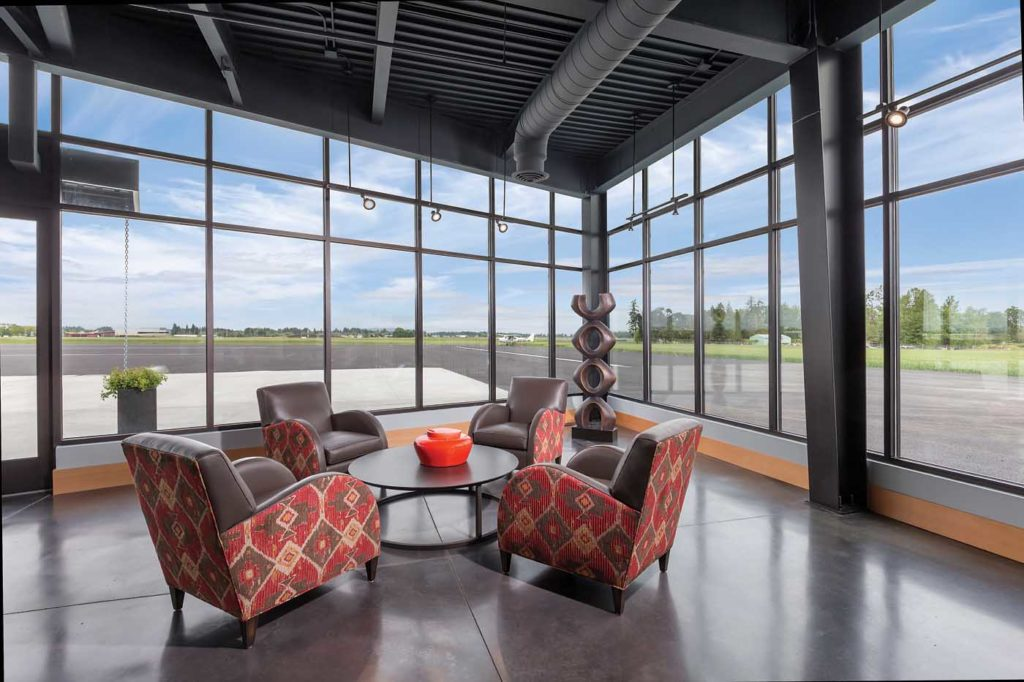 Floor-to-ceiling windows give visitors a spectacular view out over Hillsboro's ramp towards the natural landscape beyond. Hillsboro Aviation Photo