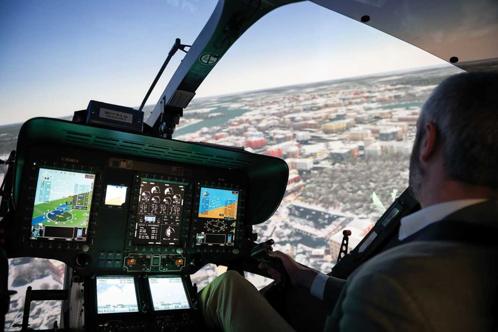 The author in Coptersafety's H145 simulator, flying over Rovaniemi in northern Finland. Lloyd Horgan Photo