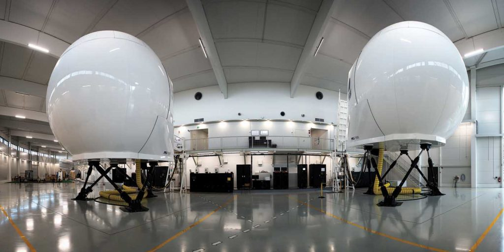 The H145 (right) and AW139 (left) simulators at Coptersafety's facility. The H125 assembly is visible in the background, and there is room for another two modules. Lloyd Horgan Photo