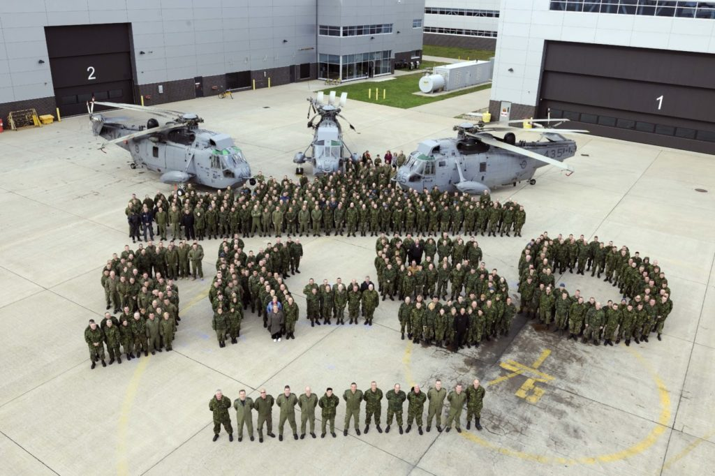 12 Wing Shearwater personnel gathered for a photo to commemorate the CH-124 Sea King helicopter's 50th anniversary. The photo was taken on the flight line in front of 423 Maritime Helicopter and 12 Air Maintenance Squadrons. Cpl Nedia Coutinho, 12 Imaging Services, Shearwater, N.S.