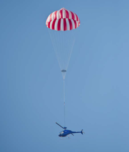 The parachute's purpose is to save the crew's life, rather than necessarily safeguard the helicopter.