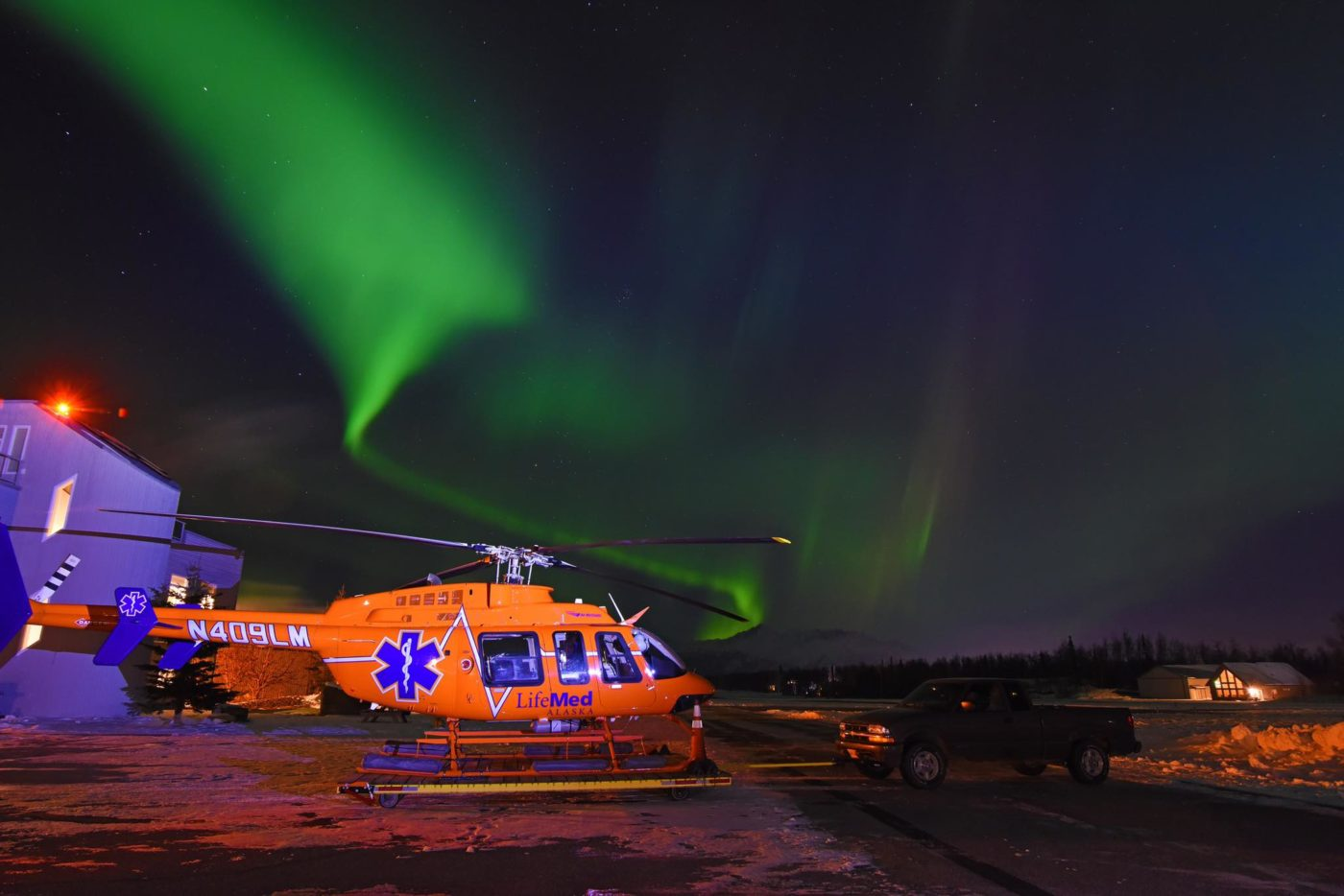 A LifeMed Alaska Bell 407 under beautiful northern lights. Photo submitted by Steven Heyano