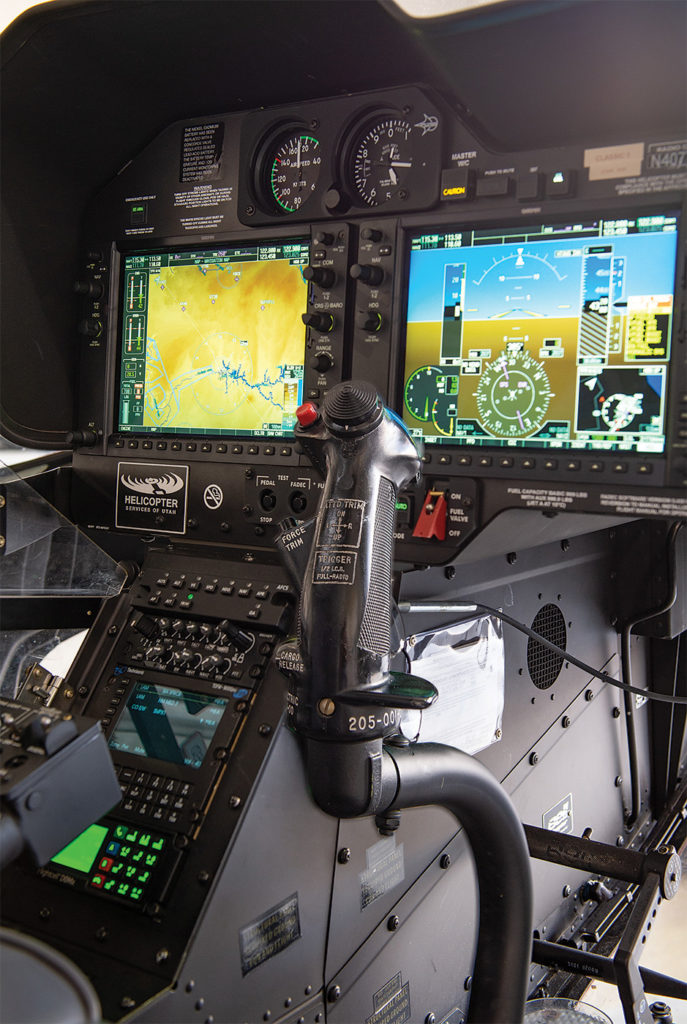 The cockpit panel of the Bell 407GXP with its Garmin G1000 avionics suite, Technisonic TDFM 9000 multi-band AM/FM radio, and Flightcell DZMx for satellite and cellular voice and data transmission and aircraft tracking. Dan Megna Photo