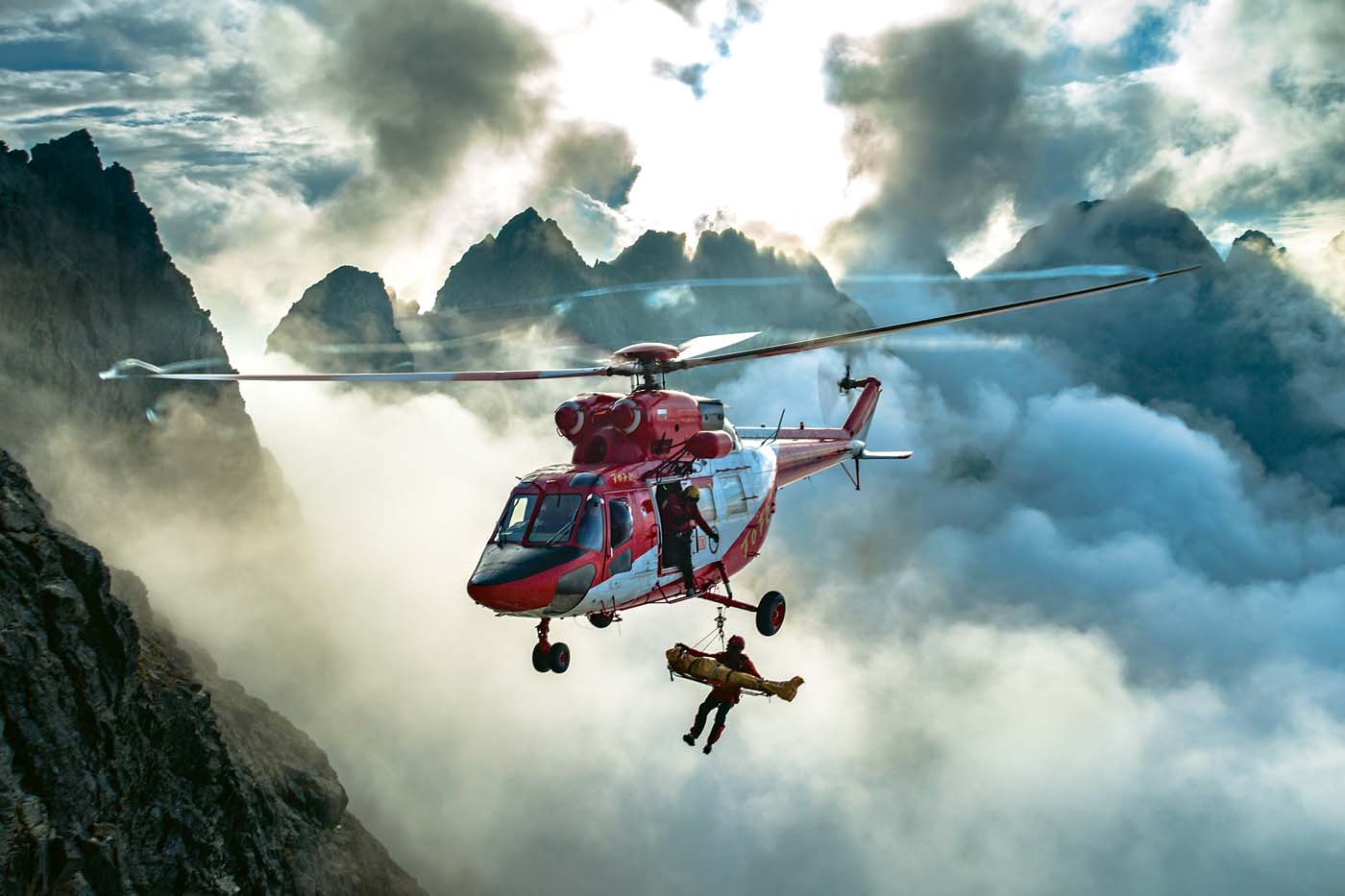 The Grand Prize winner of the 2018 Vertical Photo Contest: A PZL W-3A Sokół, operated by the Tatra Mountain rescue service (TOPR), flies a rescue mission on Rysy, the highest peak in Poland. Photo by Maciej Mikiewicz.