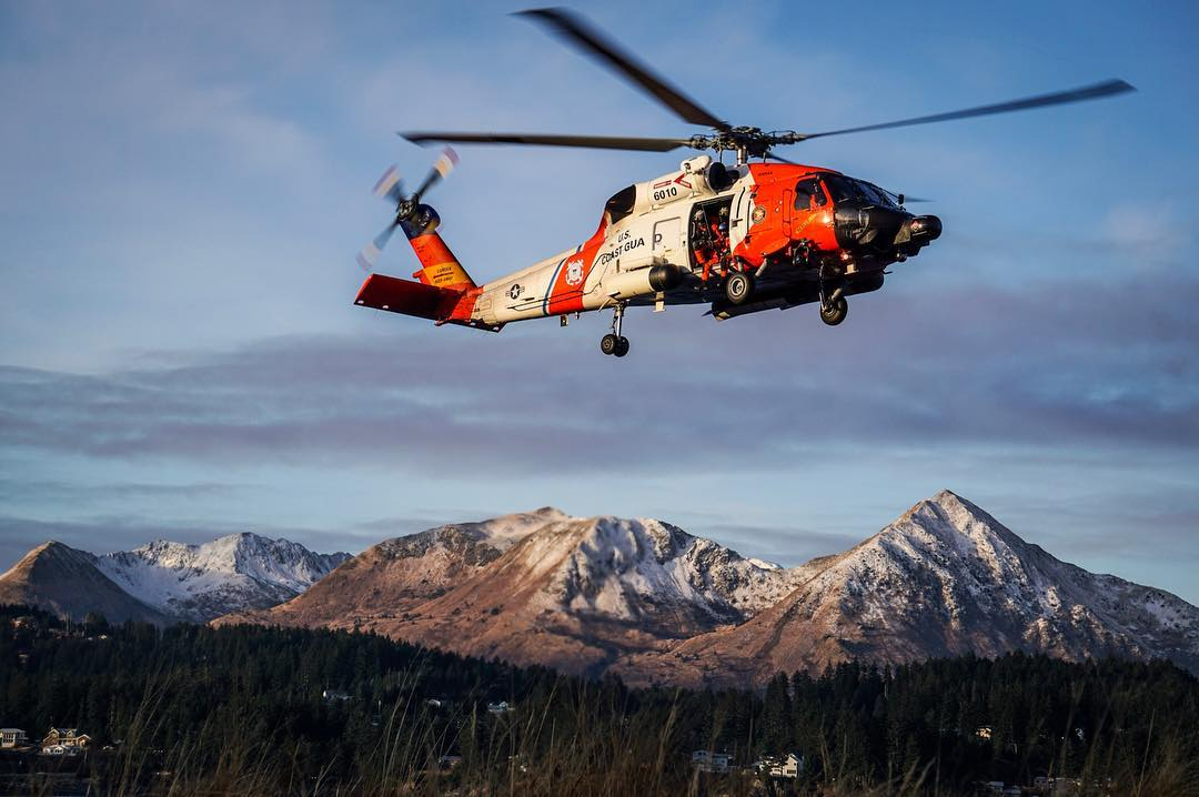 A U.S. Coast Guard MH-60 Jayhawk flies above picturesque mountains in Kodiak, Alaska. Photo submitted by Bradley Pigage (Instagram user @akstache_646) using #verticalmag