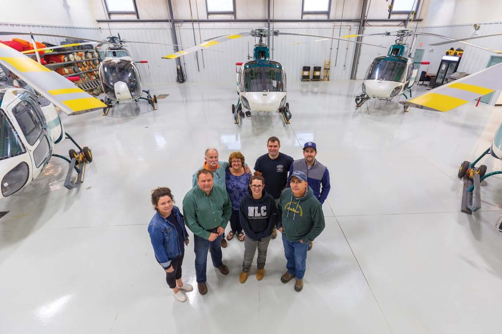 George and Debbie Kelham (back left) started Slave Lake Helicopters in January 1998. Almost 21 years later, the company has grown to a full-time staff of 10. Heath Moffatt Photo
