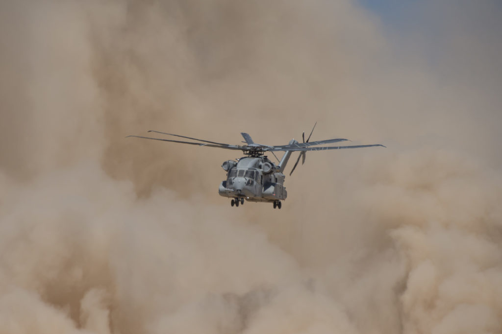 A CH-53K helicopter conducts flight testing in Yuma