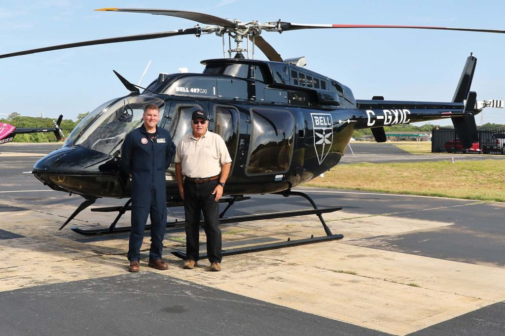 Senior Bell demonstration pilot Will Williamson (left) and the author pose in front of the 407GXi flown for this report. Guy R. Maher Photo