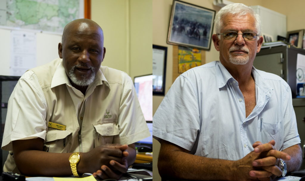 Mbongeni Tukela, left, directs the operations center at Kruger National Park. Kobus de Wet is SANParks' national head of environmental crime investigations.