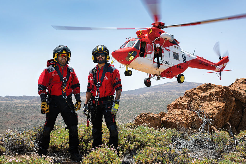 A typical GES crew for SAR missions - one captain, one co-pilot, one winch operator/flight engineer and two rescue swimmers - are photographed here in Teide National Park on Tenerife. Lloyd Horgan Photo