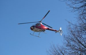 Charlie Weigandt, the programs director and chief helicopter pilot, lowers GOV 1 onto APSU's campus. APSU Photo