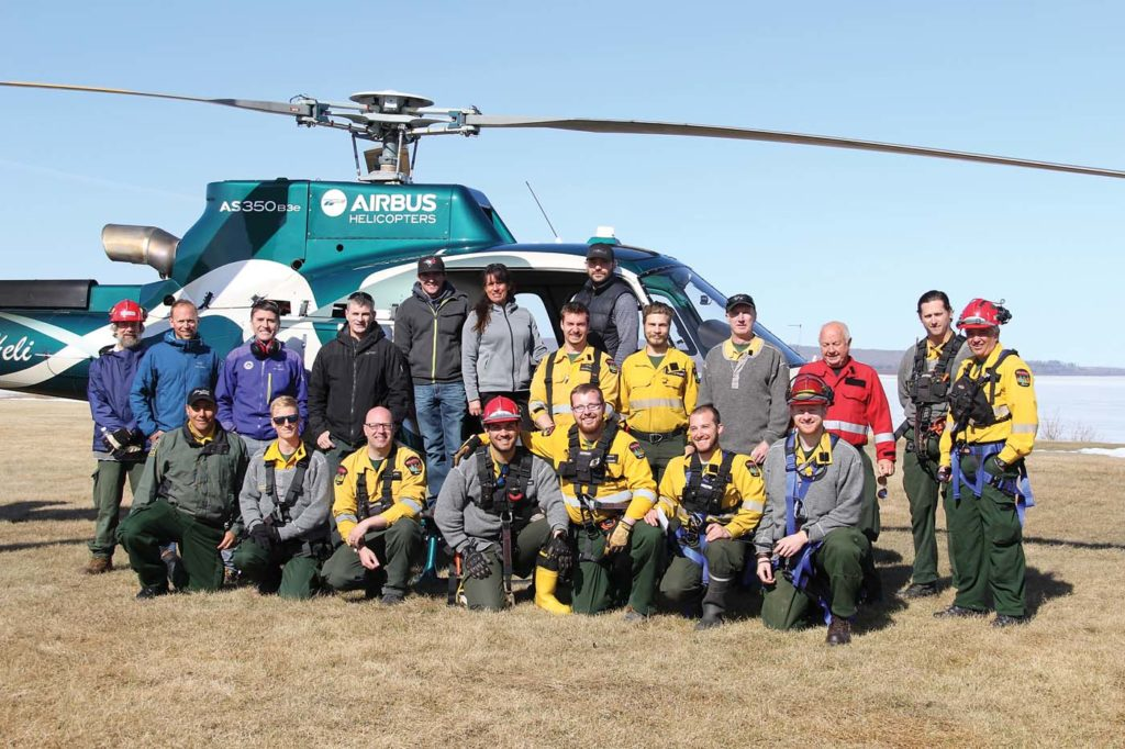 Firefighters and Slave Lake Helicopters staff pose for a photo in front of one of the operator's H125s during the first session of the HEC pilot project. Alberta Agriculture and Forestry Photo