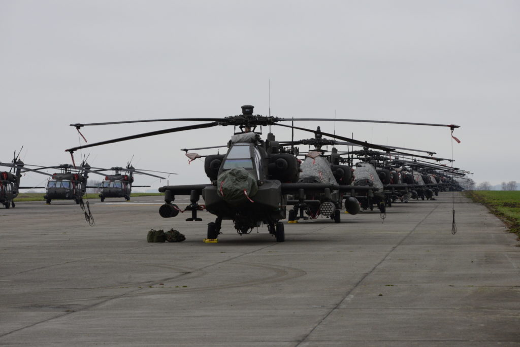 U.S. Army AH-64 Apache and UH-60 Black Hawk helicopters from the 1st Combat Aviation Brigade