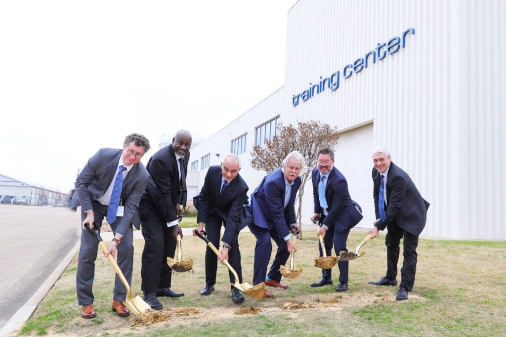 Laurent Vautherin, Airbus Helicopters' head of training; Anthony Baker, vice president of customer support, Airbus Helicopters Inc.; Jean Charles de Troy, managing director of Helisim LLC, Grand Prairie; Ron Jensen, Mayor of Grand Prairie; Chris Emerson, president of Airbus Helicopters Inc.; and Christian Cochini, CEO of Helisim. Robbie Aleman Photo