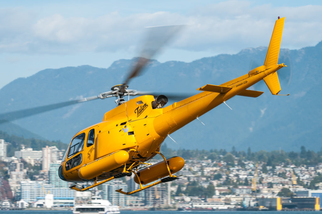 An Airbus AS350 B2, owned and operated by Talon Helicopters, flying over the Vancouver Harbour. Bill Campbell Photo