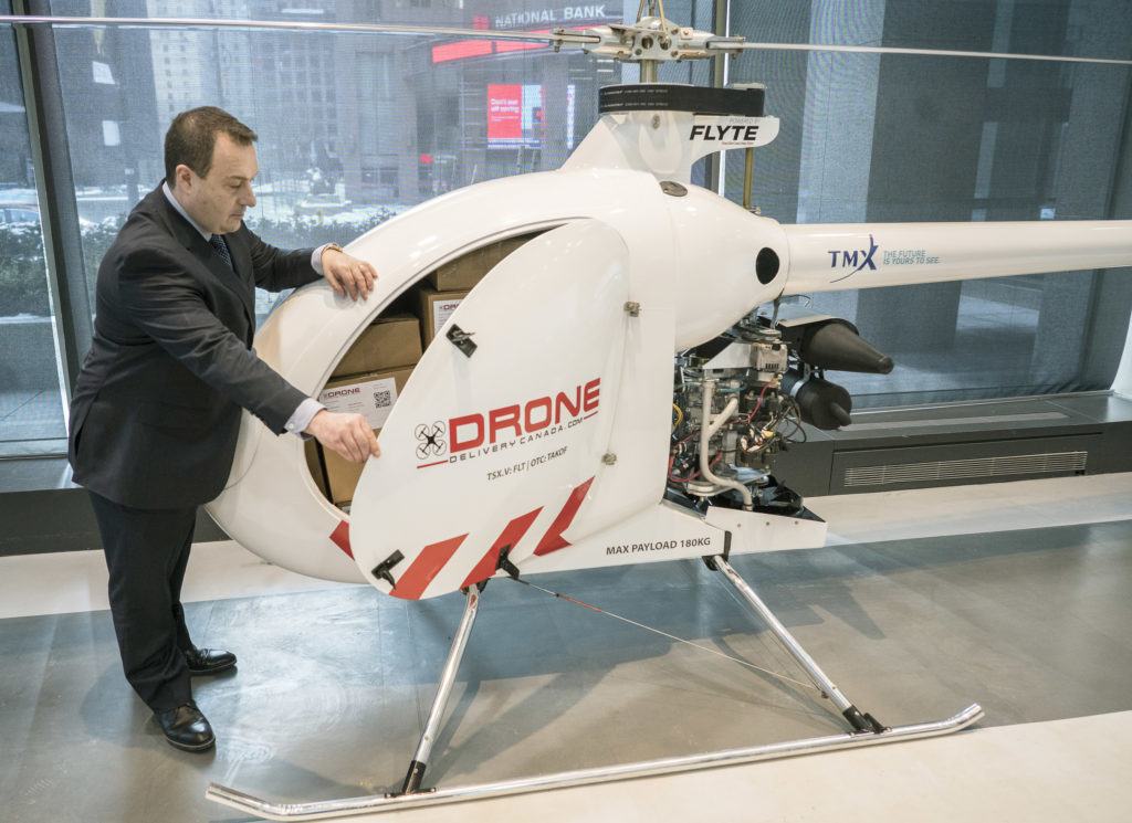 Tony Di Benedetto, CEO of Drone Delivery Canada opens the cargo bay door of his company's newest, largest and farthest range cargo delivery drone, the Condor, in Toronto, Ontario, on Feb. 19, 2019. J.P. Moczulski Photo