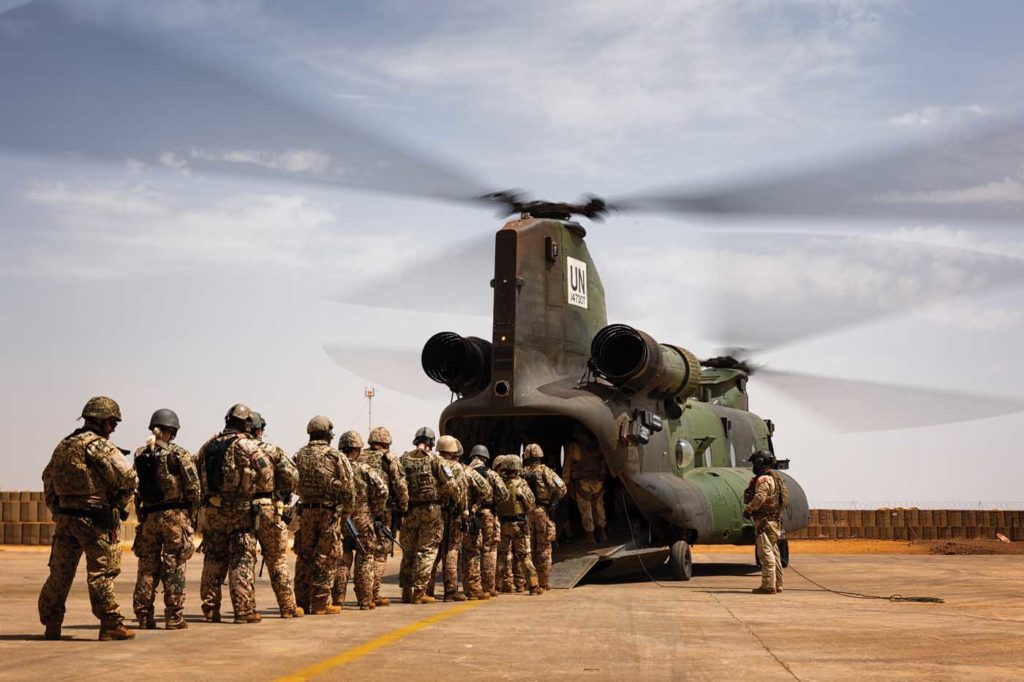 Troops prepare to board a CH-147F Chinook for a tactical airlift mission. Lloyd Horgan Photo
