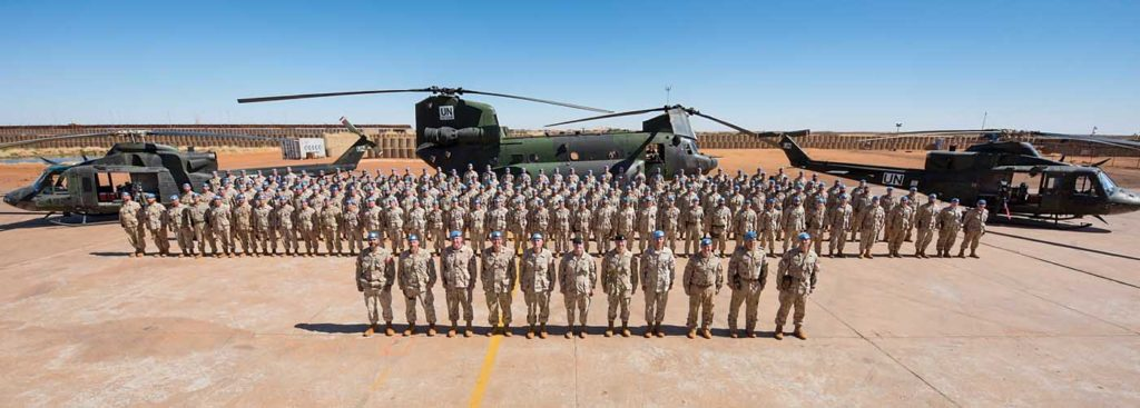 Members of the Canadian Armed Forces deployed to Mali pose for a group photo on their ramp in Gao. DND Photo