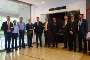 Celebrating the opening of Liebherr-Aerospace's new office in Bangalore, India: Representatives of Liebherr India Private Limited, Liebherr-Aerospace & Transportation SAS, and Liebherr-Aerospace Lindenberg GmbH. Liebherr Photo