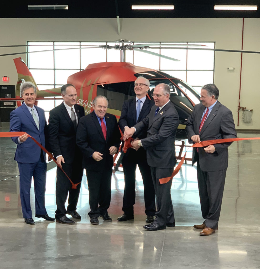 Louisiana Gov. John Bel Edwards and Kopter CEO Andreas Löwenstein cut the ribbon in the manufacturer's new facility in Lafayette, Louisiana. Kopter Photo
