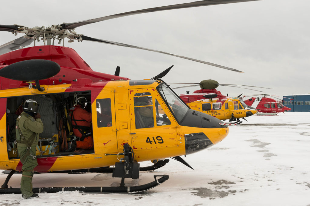 Two RCAF Bell CH-146 Griffons and a Canadian Coast Guard Bell 429 prepare for a search in the Timmins, Ontario, region on March 10, 2019. Corporal Zebulon Salmaniw Photo