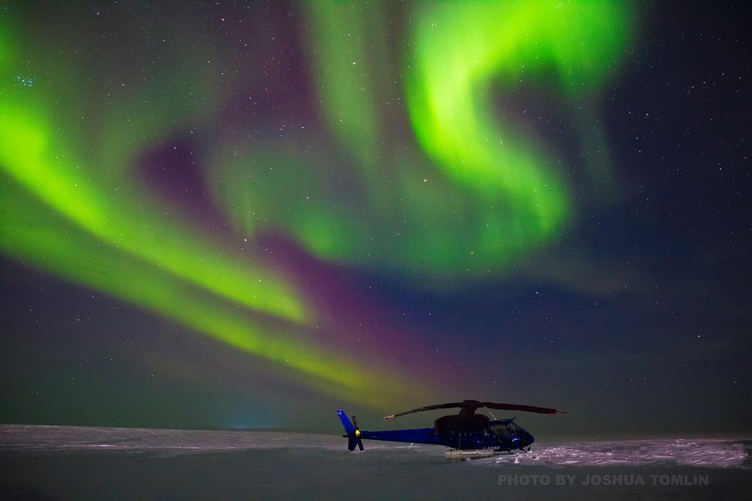 An Airbus AS350 AStar sits under the northern lights. Photo submitted by Joshua Tomlin (Instagram user @joshuartomlin) using #verticalmag