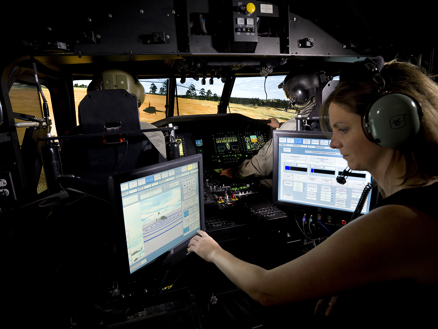 Transportable-Black Hawk Operations Simulator, with male and female pilots