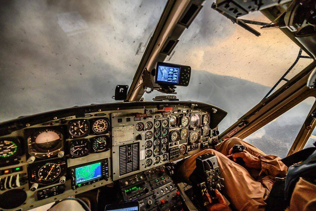 The view from the cockpit of a Bell 412 over wildfires. Photo submitted by James Williams (Instagram user @overlandpilot) using #verticalmag