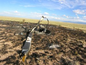 Helicopter wreckage with fire damage