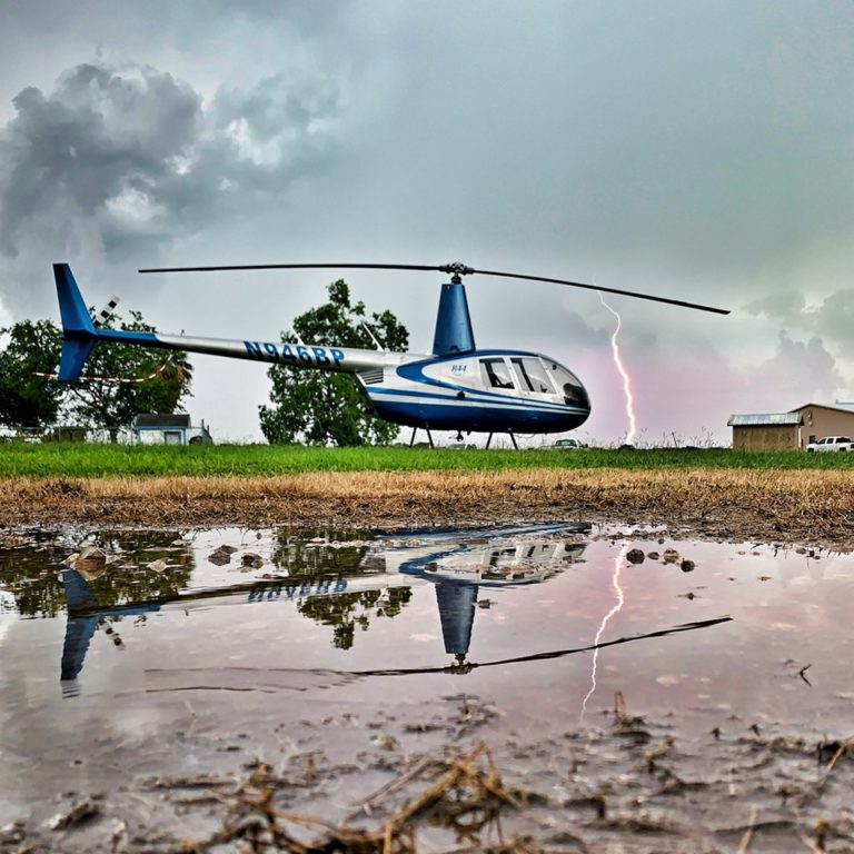 A Robinson R44 operated by South Texas Helicopters rests as a storm passes. Photo submitted by Rick Sá