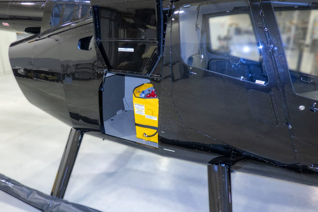 The R66 Slimline Fuel Tank holds 23.2 US Gallons of fuel. Robinson Helicopter Photo