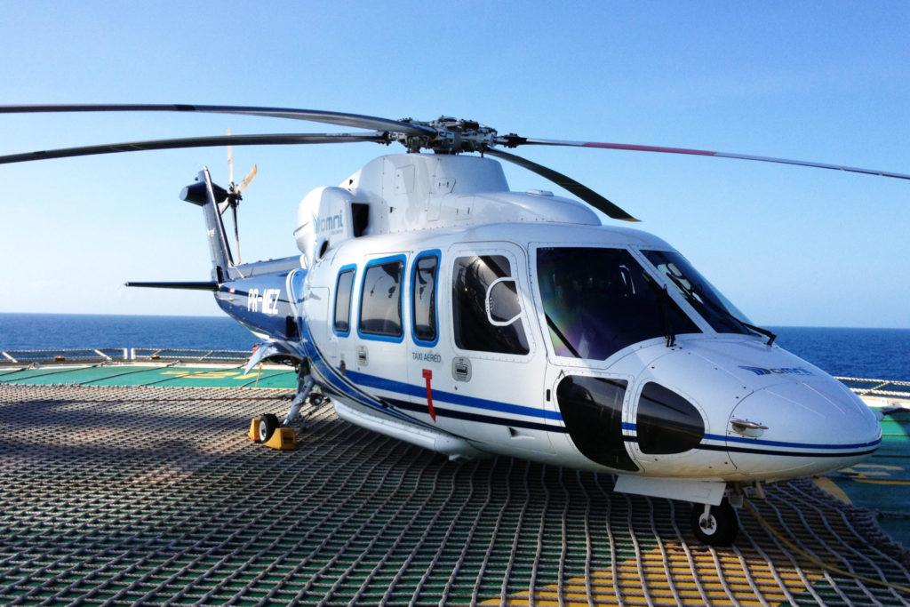 A Sikorsky S-76C, operated by Omni Taxi Aero, takes a rest at an offshore facility. Omni Taxi Aero Photo