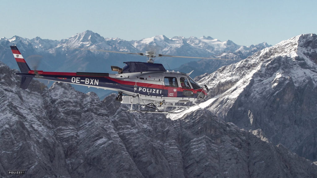 An Austrian BMI Airbus H125 flies over the Alps. Airbus Helicopters Photo