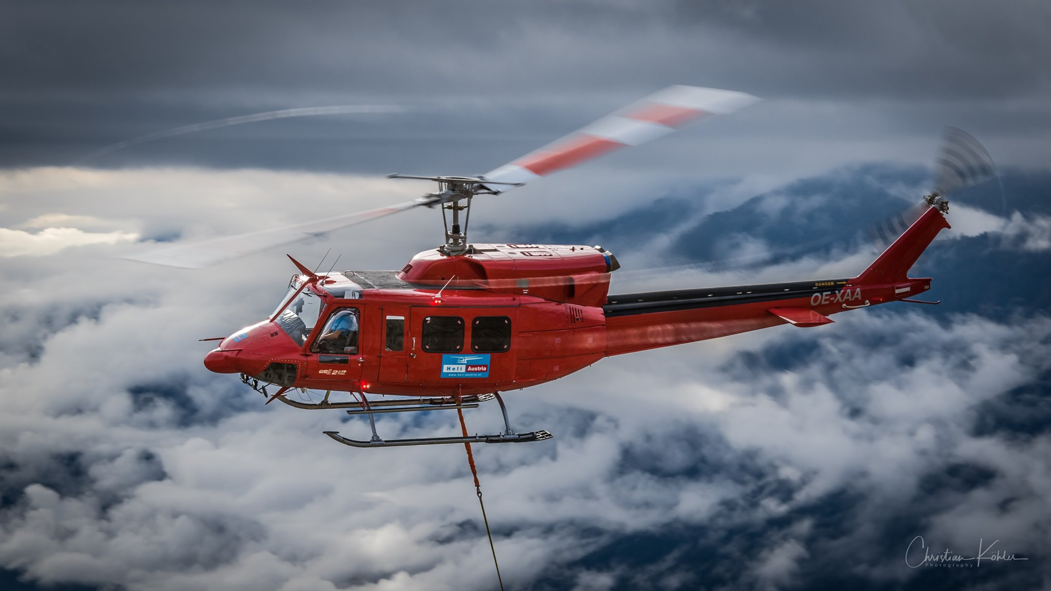 A Bell 212 above the clouds. Photo submitted by Christian Koehler