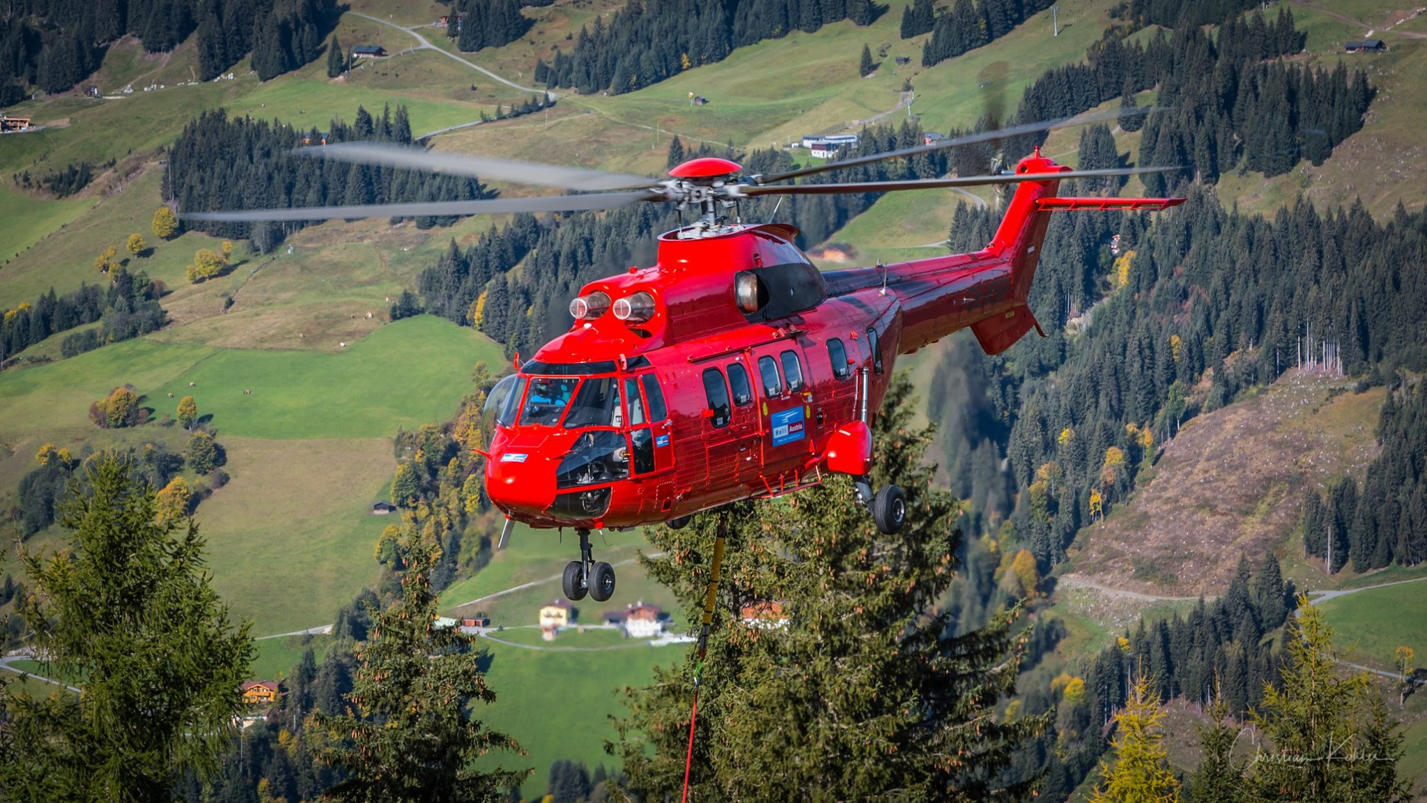 A Heli Austria Airbus AS332L1 Super Puma performs external load operations. Photo submitted by Christian Koehler