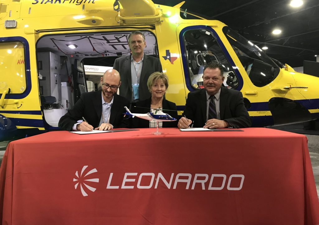 Officials from Leonardo and Intermountain Life Flight sign a contract for the new aircraft at AMTC 2019. Leonardo Photo