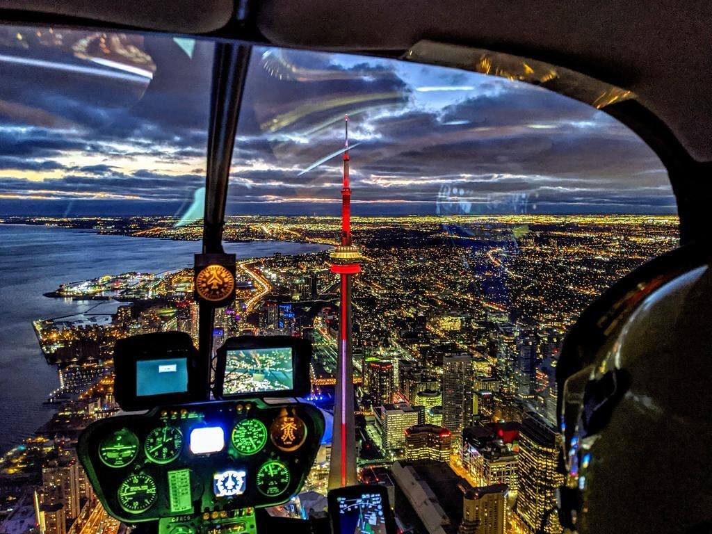 Stunning capture from a Robinson R44 of downtown Toronto lit up at dusk. Photo taken by Ari Rabinovitch (@ari_traffic), submitted by Martin Schubert (Instagram user @martinschubert1) using #verticalmag