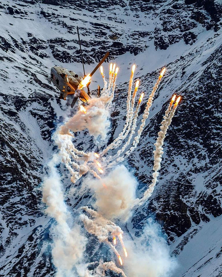 A Super Puma pops flares at the Axalp Airshow. Photo submitted by Jarek Weksej (Instagram user @jarek.weksej) using #verticalmag
