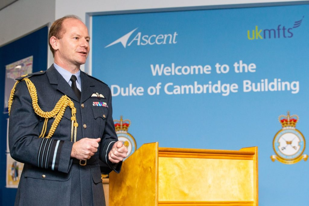 Air Chief Marshal Wigston, Chief of the Air Staff, addresses guests and staff at the official naming of The Duke of Cambridge building as part of No. 1 Training School at RAF Shawbury in Shropshire. RAF Photo Chief of the Air Staff, Air Chief Marshal Wigston CBE ADC has formally named a new flying training facility at RAF Shawbury's No. 1 Flying Training School as The Duke of Cambridge Building in honour of The Duke of Cambridge' who completed his own flying training at Shawbury during his years in the Royal Air Force. The Duke of Cambridge Building is part of the UK Military Flying Training System and houses state of the art training simulators and aides to enable future rotary pilots and aircrew to learn many of their skills before getting airborne in the modern fleet of 29 Juno (H135) and 3 Jupiter (H145) helicopters. The event also marked the official rebadging of the Defence Helicopter Flying Training School to No. 1 Flying Training School, and was also attended by the Lord-Lieutenant of Shropshire Anna Turner JP.