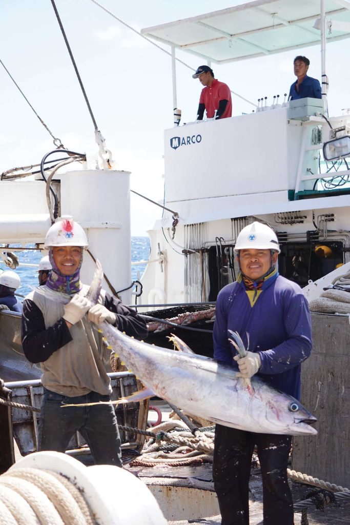 Two crewmembers pose with an average-sized yellowfin tuna. Matthew Hayes Photo